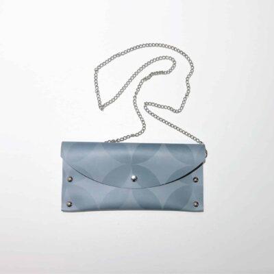 Siniharmaa käsilaukku